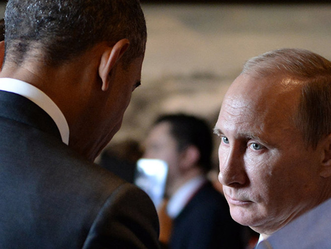 Barak Obama i Vladimir Putin - Foto: AFP